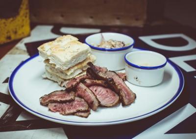 Pit Beef - Beef Round, House Rub, Focaccia, Mustard, Spicy Slaw