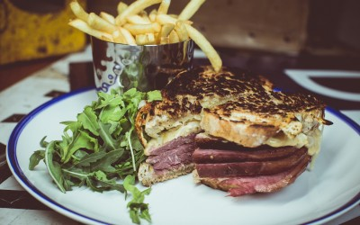 Rueben Sandwich - Salt Beef, Swiss Cheese, Sauerkraut, Mustard, Rye Bread, Fries